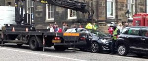 Speciality car removal truck removing a parked car with difficult towing access